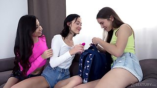 Teen brunettes stretching their assholes with a pink sex toy