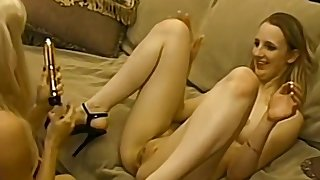 Retro video of four lesbian friends having some sport with dildo