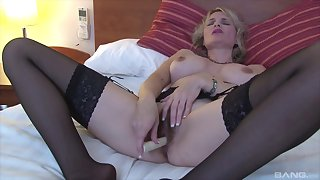 Mature blonde slut uses a basic toy on her battle-scarred snatch