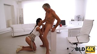 Tanned slender nympho is all nude and goes crazy riding fat cock